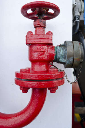 water pipe with a red valve photo