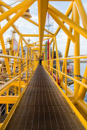 Oil platform yellow color in the sea photo