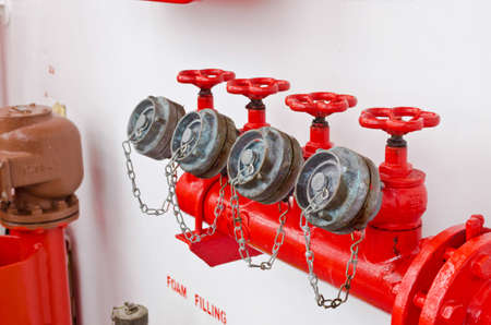 water pipe with a red valves photo