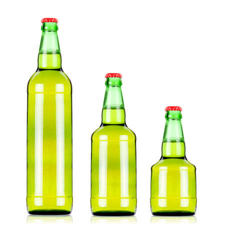 three  green beers bottles of different size over white background green beer bottles photo