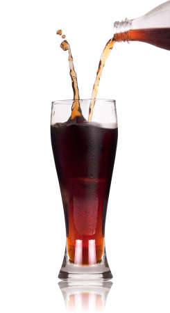 A Bottle of cola soda pouring into a glass over a white background with reflection Stock Photo - 13963205