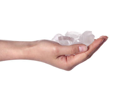 hail: Ice cold hand  Woman hand holding ice cubes - closeup