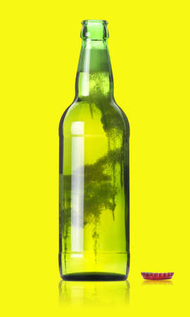 wallop: opened beer bottle on  a yellow background