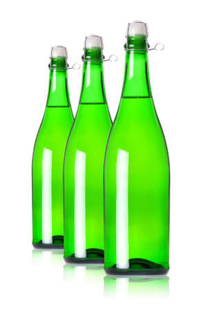 Three bottles of champagne in row on white background  photo