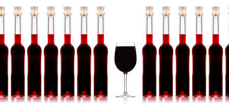 Bottles of wine and wineglass isolated on white background photo
