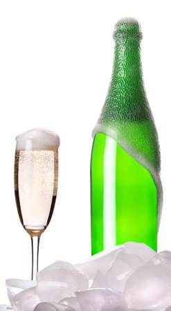 Champagne in ice and champagne flutes isolated on a white background photo