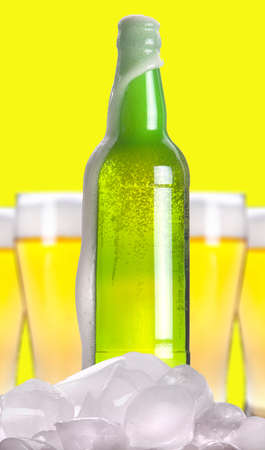 ported: Open beer bottle with ice and foam on a white background