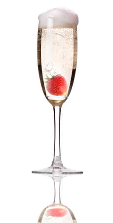 Champagne with strawberry - christmas alcohol cocktail  Isolated on white background photo