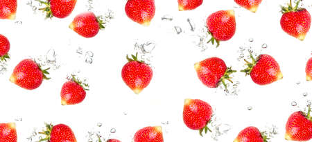 Juicy strawberries under water  Healthy and tasty foods isolated on a white background photo