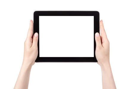 Hands of a woman holding digital tablet displaying a white screen  photo