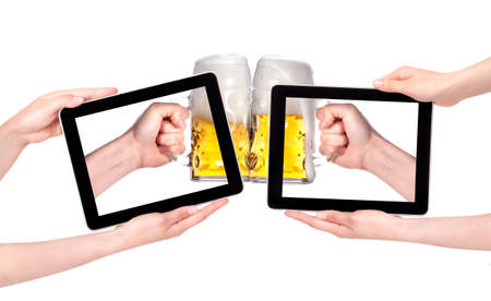 isolated Hands Holding Digital Tablet with beers making a toast on a white photo
