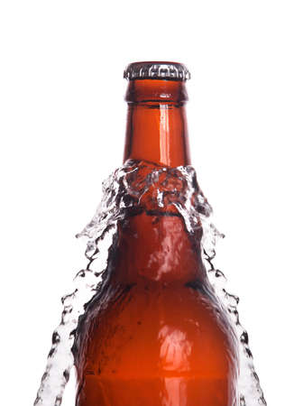 Beer bottle with water splash isolated on a white background photo