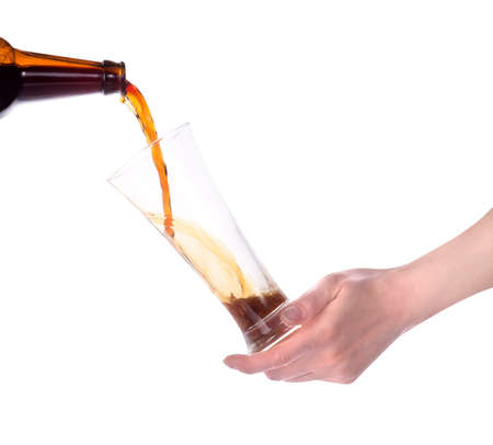 hand holding glass of beer isolated making toast photo