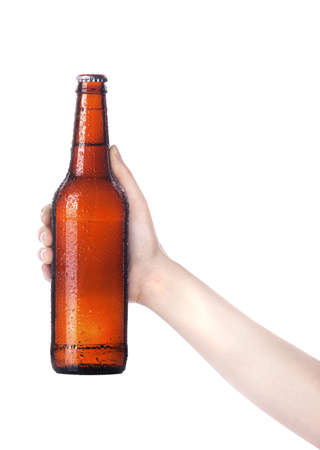 hand holding bottle: hand holding Bottle of beer with drops isolated on a white background Stock Photo