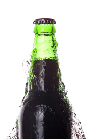 dark Beer bottle with water splash isolated on a white background photo