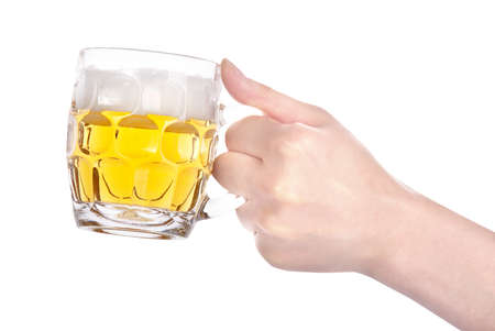 hand holding small mug of beer isolated on a white background making toast photo