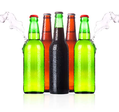 frosty Beer bottles with water splash isolated on a white background photo