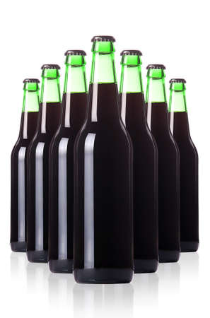 row of dark beer Bottles isolated on a white background photo