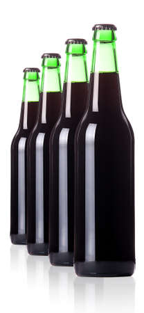 dewed: row of dark beer Bottles isolated on a white background