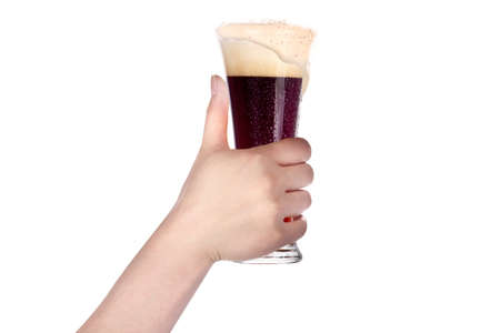 hand holding glass of beer isolated on a white background making toast photo