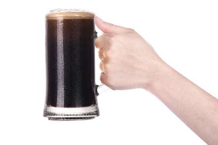 hand holding mug of beer isolated on a white background making toast photo