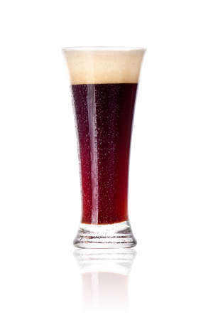 Frosty glass of dark beer with foam and water drops isolated on a white background photo