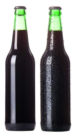 two Bottles of dark beer with drops isolated on white background. photo
