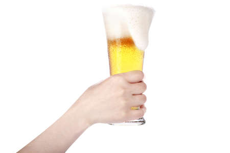 hand holding glass of beer isolated on a white background.making toast photo
