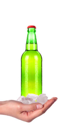 hand holding Bottle of beer with drops isolated on a white background photo