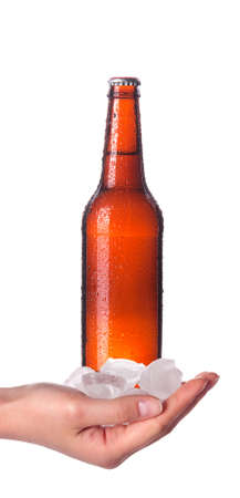 hand holding Bottle of beer with drops isolated on a white background Stock Photo - 14442454