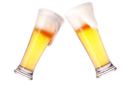 Pair of beer glasses making a toast isolated on a white background photo