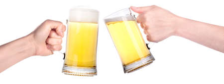 Pair of beer glasses with hand making a toast isolated on a white background photo