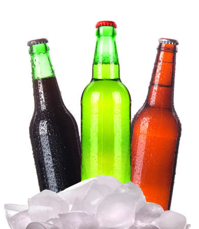 Three bottles of beer with ice isolated on white background photo