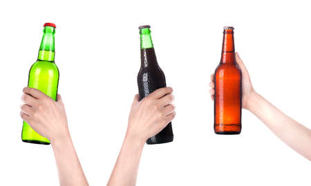 collection of isolated hands with beer bottle making a toast over white background photo