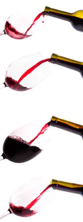 collection of Red wine pouring down from a bottle isolated on a white background photo