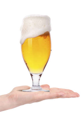 hand offering glass of beer  in ice isolated on a white background making toast photo