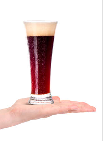 dewed: hand offering glass of beer  in ice isolated on a white background making toast Stock Photo