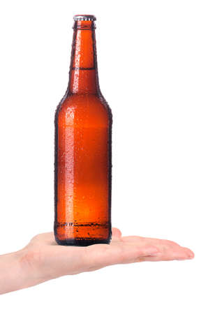 hand offering bottle of beer  in ice isolated on a white background making toast photo