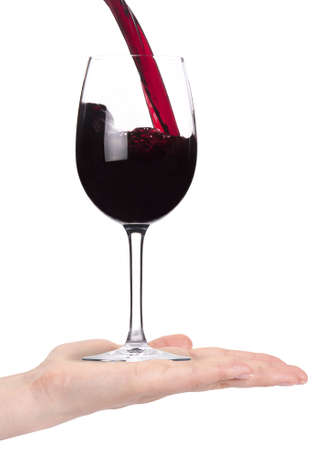 Woman hand offering red Wine isolated on a white background photo
