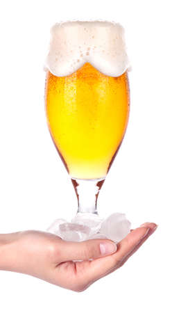 hand offering glass of beer  in ice isolated on a white background making toast Stock Photo