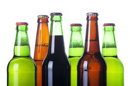 brown bottle: Frosty bottles of beer isolated on a white background