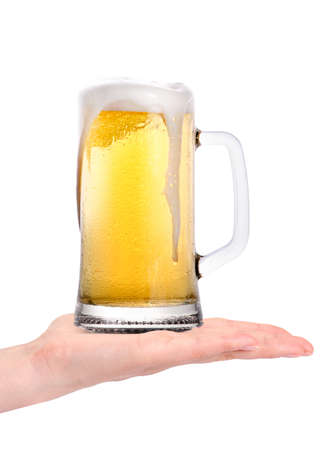 hand offering glass of beer  isolated on a white background making toast photo