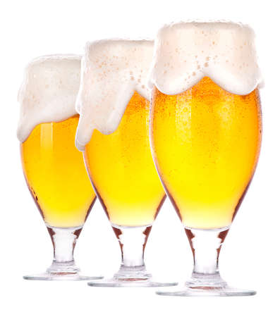 glasses of beer: Frosty fresh beer set with foam isolated on a white background Stock Photo
