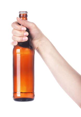 hand holding bottle: Frosty fresh bottle of beer in a hand isolated  making toast on a white background Stock Photo