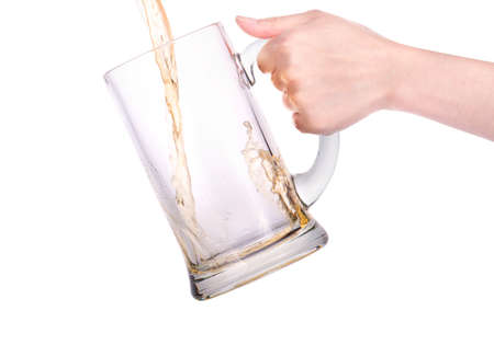 Beer into glass on a white background photo