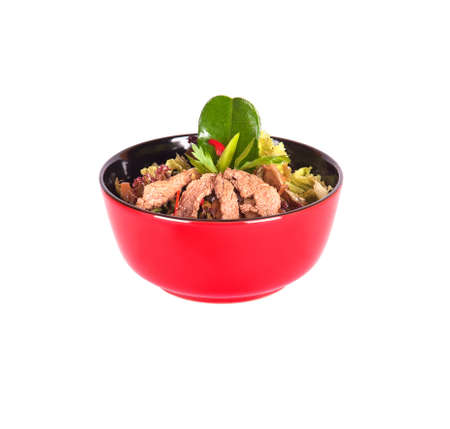 sautee: Healthy Chinese food in a red plate isolated on a white background