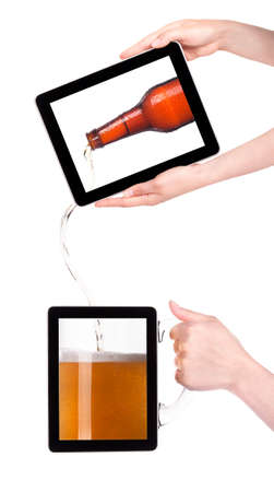 digital tablet with fresh beer pouring down from a bottle isolated on a white background Stock Photo - 15133244