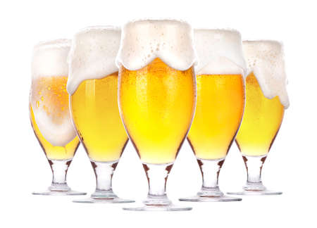 Frosty glass of beer with foam isolated on a white background Imagens