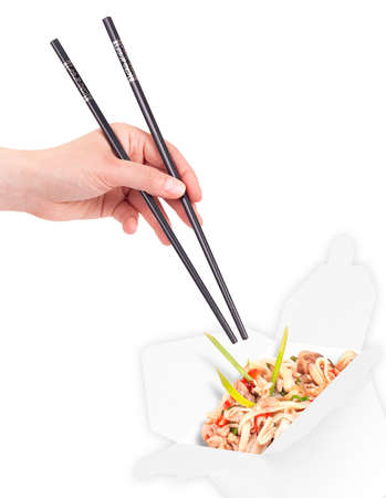 sautee: Healthy Chinese food in a container with woman hand holding chopsticks isolated Stock Photo