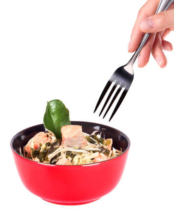 sautee: Healthy Chinese food in a red plate and hand with fork isolated on a white background